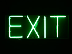 green neon exit hire sign