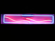 narrow stream abstract neon hire sign