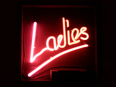 neon ladies bathroom sign for hire