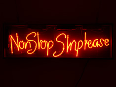 non stop strip tease red neon sign