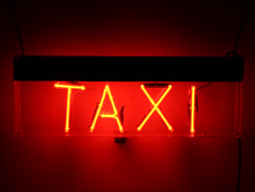 taxi neon sign in red for hire
