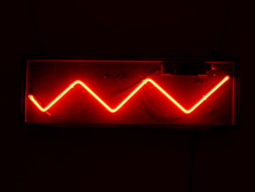 red neon zigzag sign
